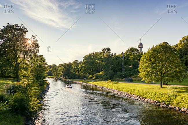 Sweden, Uppland, Stockholm, Djurgarden, Boat on canal in park