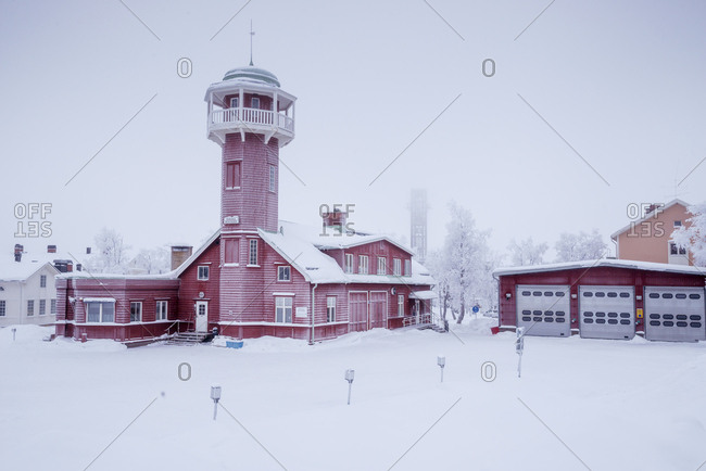 Sweden, Lapland, Kiruna, Brick building with tower against clear sky