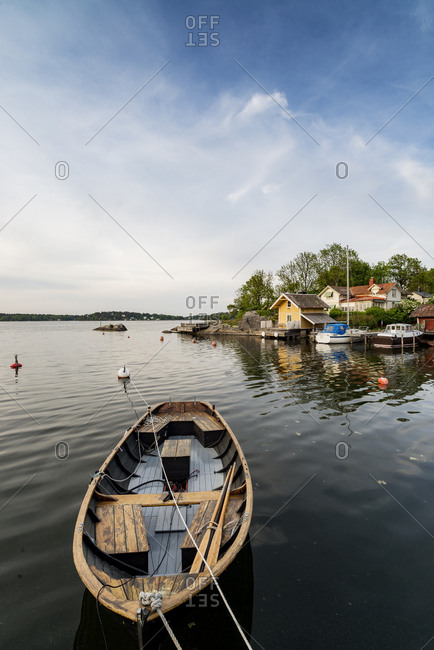 Sweden, Stockholm Archipelago, Uppland, Vaxholm, Rowboat and waterfront in background