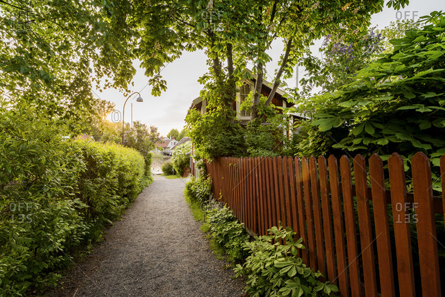 Sweden, Stockholm Archipelago, Uppland, Vaxholm, Wooden fence along footpath