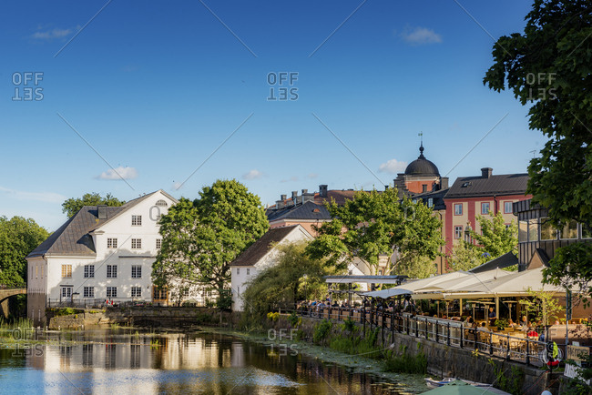 Sweden, Uppland - December 20, 2016: Houses and cafe by pond