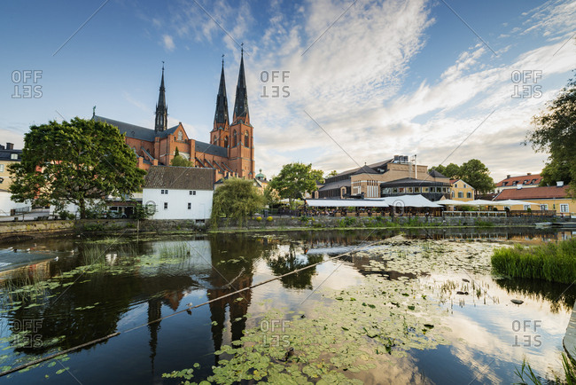 Sweden, Uppland - December 20, 2016: Uppsala Cathedral by pond