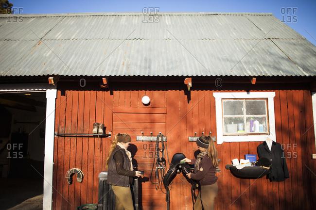 Sweden, Uppland, Faringso, Women standing in front of barn