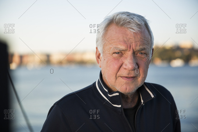 Sweden, Stockholm, Portrait of senior man against sea