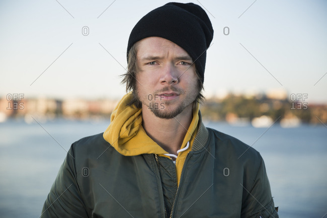 Sweden, Stockholm, Portrait of man against sea