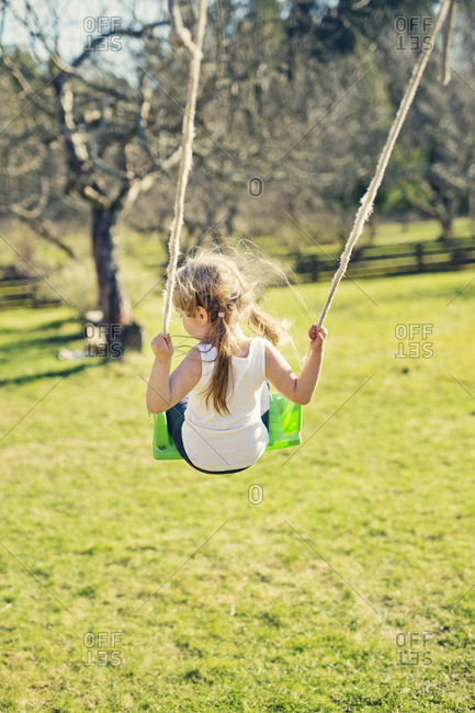 Finland, Paijat-Hame, Heinola, Rear view of girl on swing