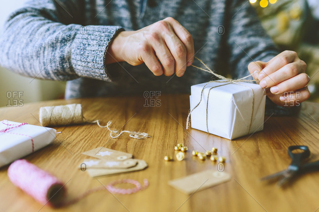 Finland, Man wrapping Christmas gifts