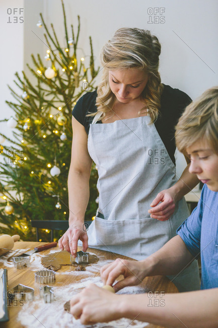 Finland, Couple preparing Christmas cookies