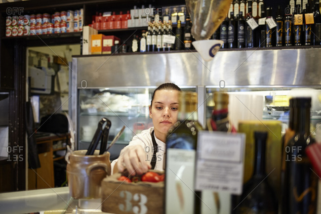 Sweden, Woman working in store