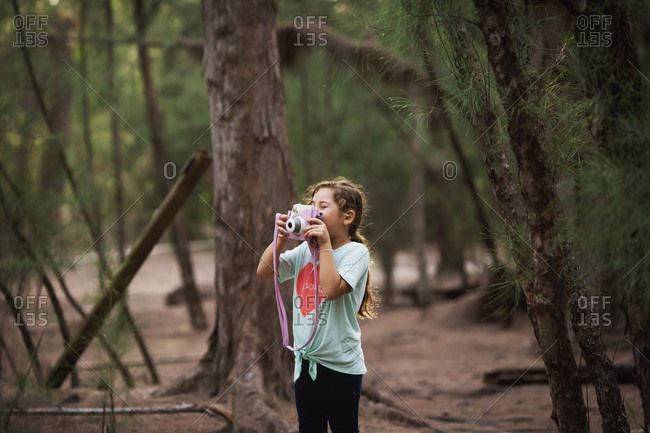 Young girl photographing while on a nature adventure