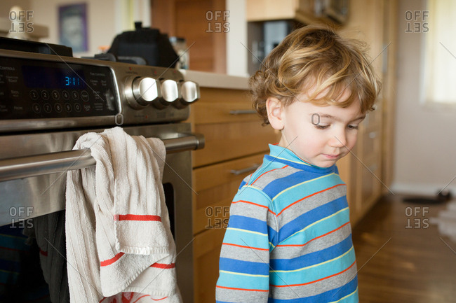 Young boy standing in the kitchen