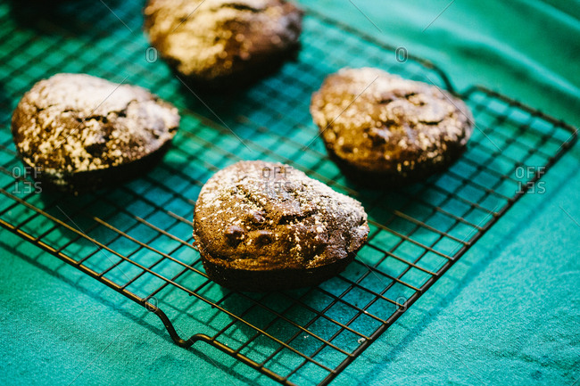 Heart shaped chocolate muffins on cooling rack