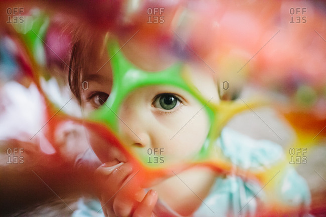 Baby looking through hole in toy