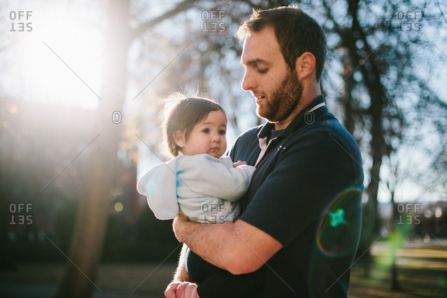 Man and girl in the sunlight