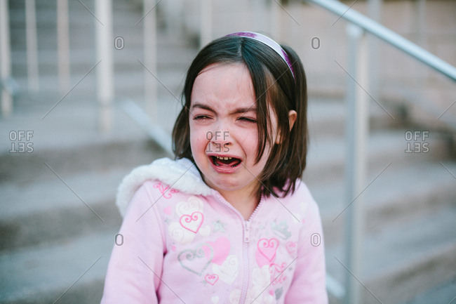 Young girl crying, portrait