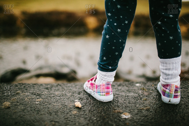 A girl in plaid shoes
