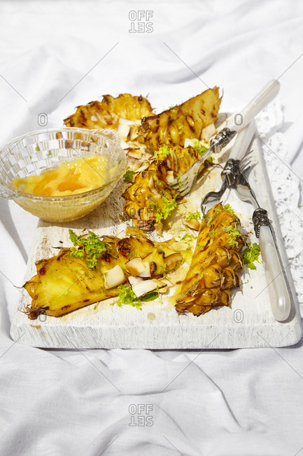Grilled pineapple with honey-butter and lime zest and almonds