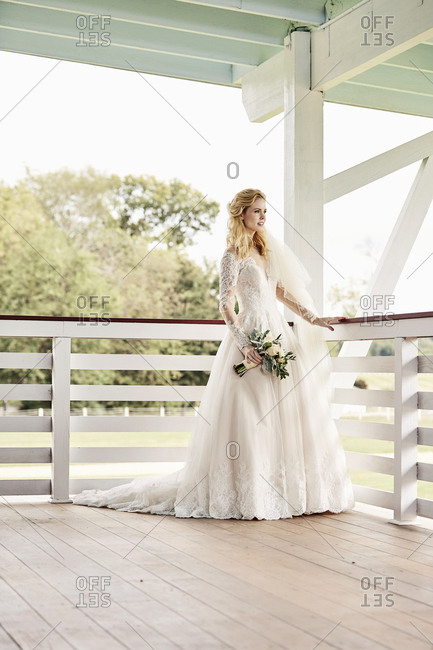 Bride standing on covered porch