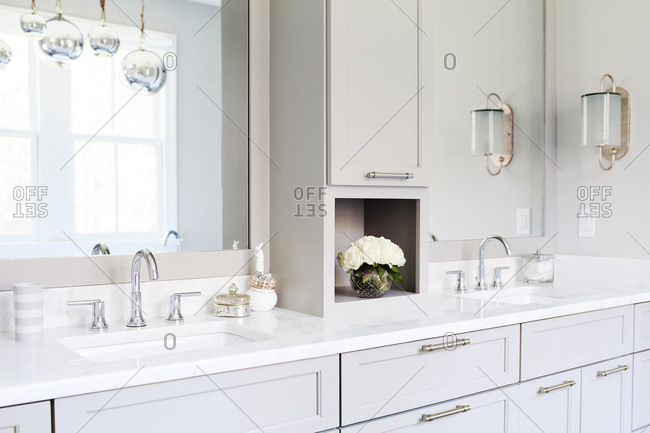 Midlothian, Virginia, USA  - November 16, 2016: Modern white bathroom with marble countertops