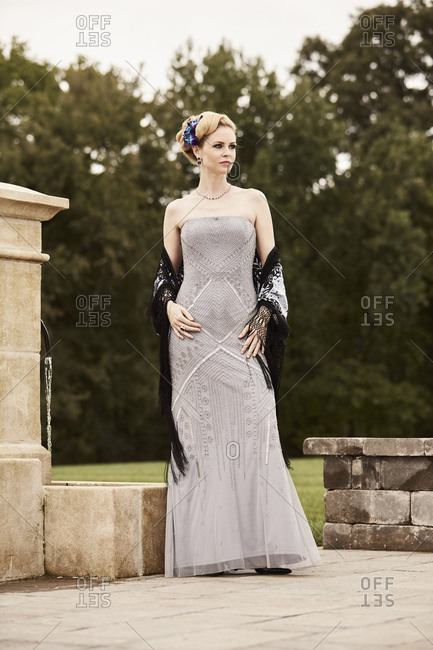 Portrait of woman in gray beaded dress with shawl