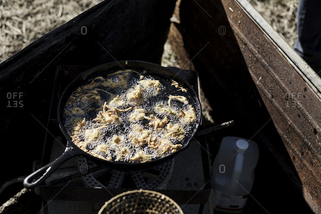 Food frying on outdoor stove