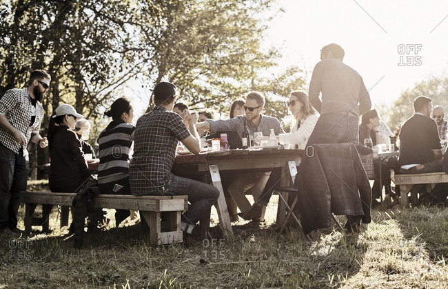 Virginia, USA - October 23, 2016: Guests at outdoor dinner party on farm