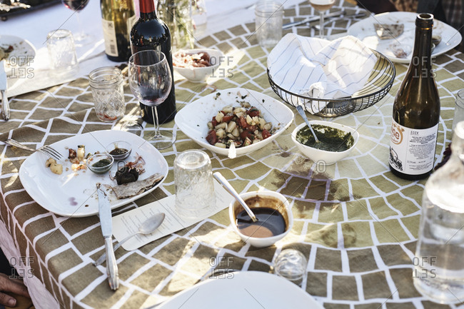 Virginia, USA - October 23, 2016: Outdoor dining table with bottles of wine