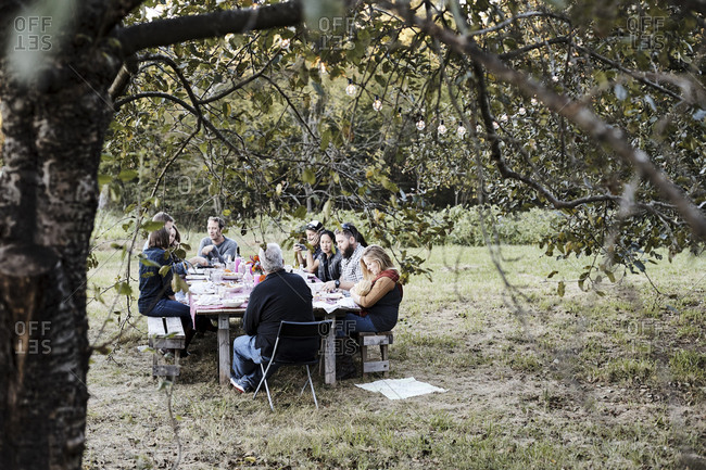 Virginia, USA - October 23, 2016: People at dining table on farm