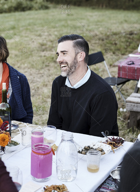 Virginia, USA - October 23, 2016: Happy dinner guest laughing at party