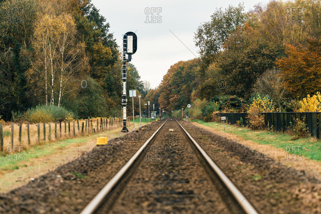 Rail track in rural autumn landscape.