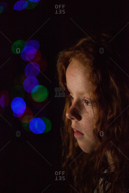 Profile of a young girl in low light