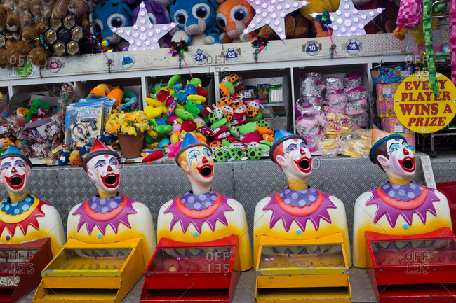 Lismore, NSW, Australia - October 22, 2016: A row of carnival games clowns