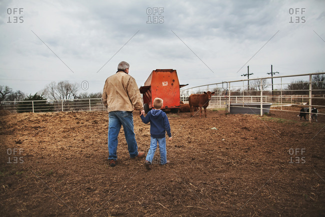 Grandfather walking with boy