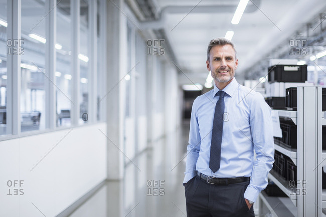 Portrait of a manager on the shop floor of a factory