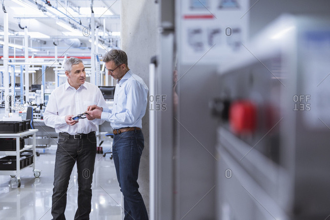 Two managers in company - discussing new product