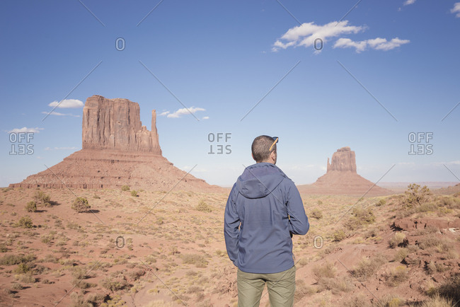 USA - Utah - back view of man looking at Monument Valley