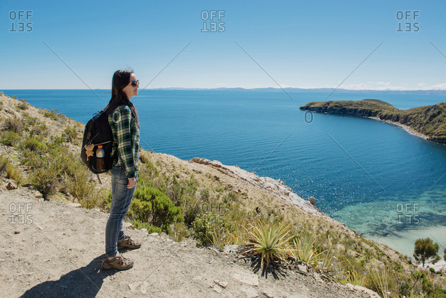 Bolivia - Titicaca lake - Isla del sol - woman with backpack enjoying the view