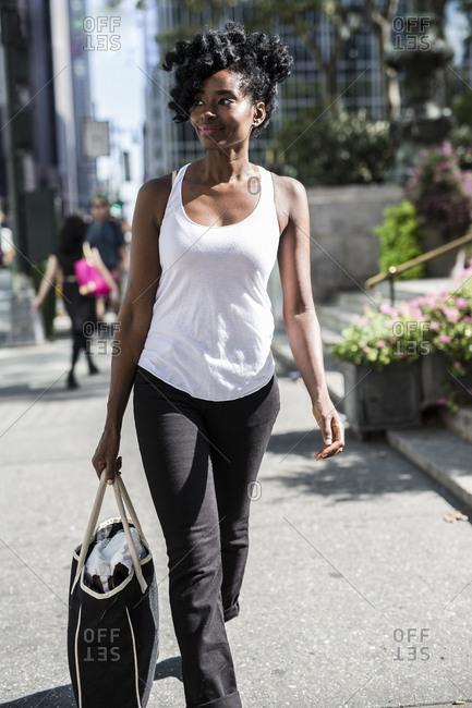 USA - New York City - Manhattan - smiling woman with shopping bag