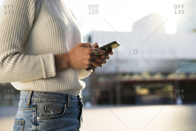 Woman text messaging - partial view
