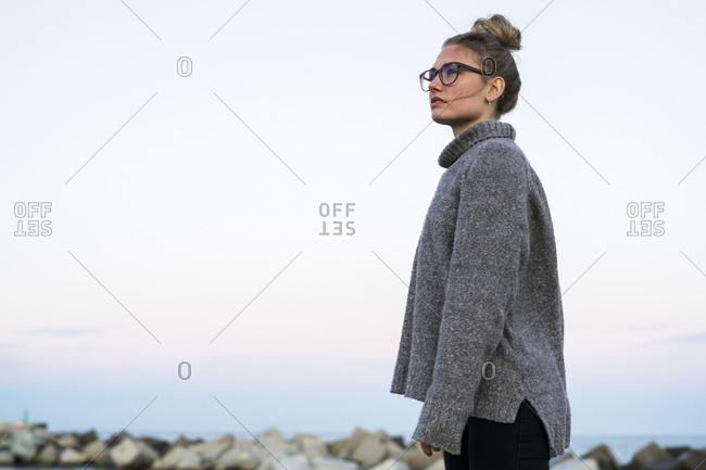 Young woman wearing glasses looking at distance