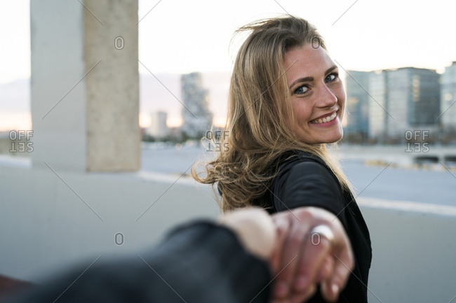 Spain - Barcelona - portrait of happy young woman holding hand