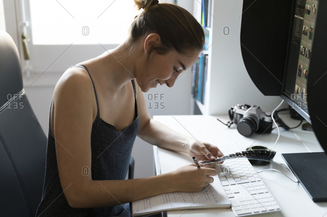 Female photographer editing images at desk