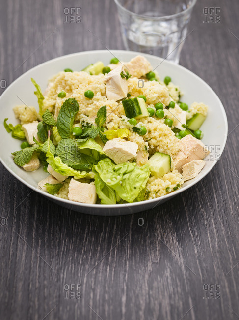 Dish of couscous salad with chicken meat