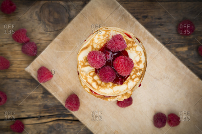 Stack of pancakes with raspberries and raspberry jam