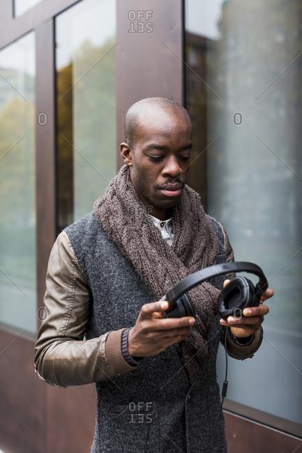 Bald man with headphones