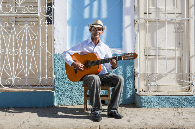 Cuba - Trinidad - portrait of man playing guitar on the street