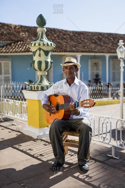 Cuba - Trinidad - man playing guitar on the street
