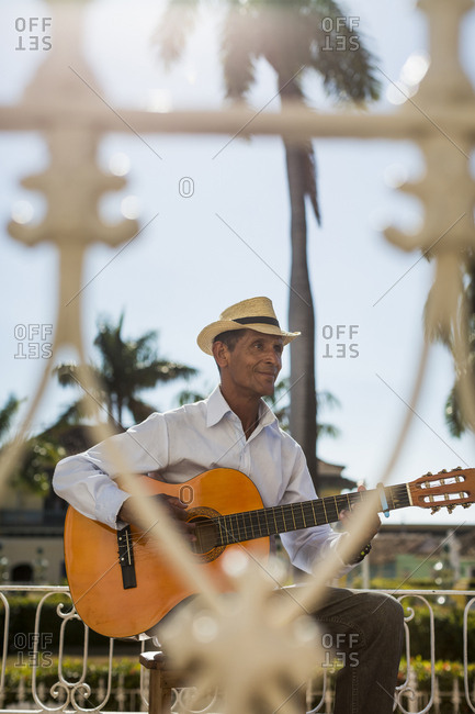 Cuba - Trinidad - man playing guitar on the street