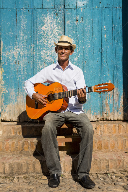 Cuba - portrait of man playing guitar on the street