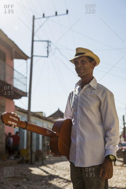 Cuba - Trinidad - man with guitar on the street